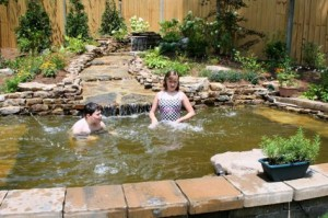 Hannah and Wyatt cool off in their beautiful wading pool.