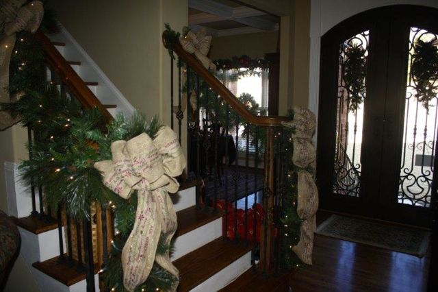 Christmas garland and ribbon adorns the bannisters.