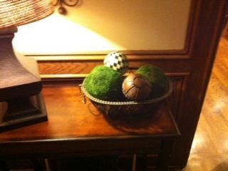 A bowl full of spheres is updated with a couple of moss covered balls.