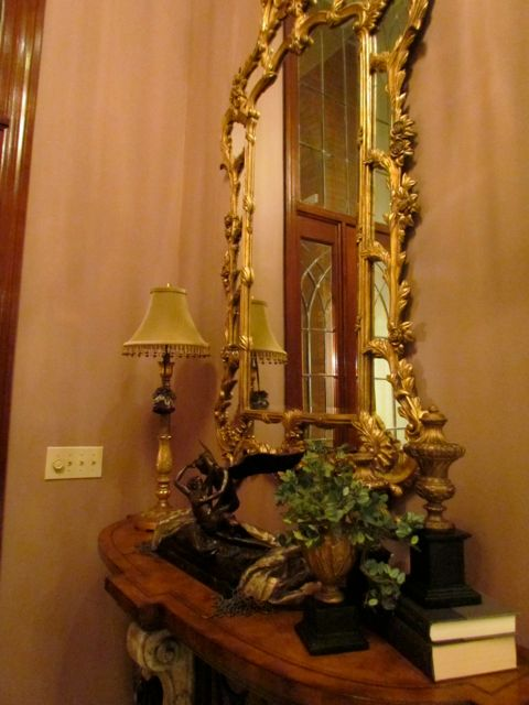 Beautiful gilded mirror in foyer.