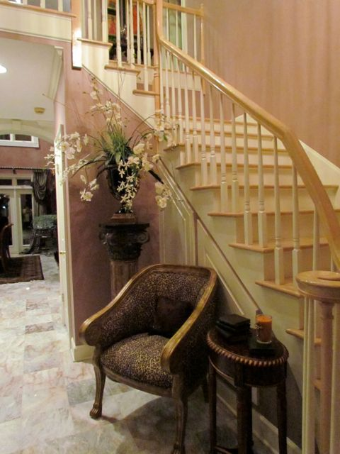 Foyer with curved staircase.